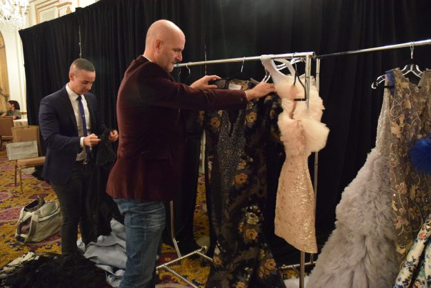 Michael DePaulo and his husband arranging the wardrobe for the show. Taken by Temi Adeleye.